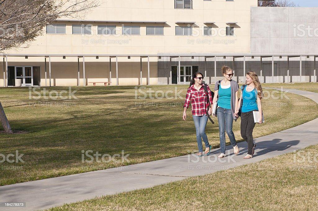 Girls on Campus Sidewalk royalty-free stock photo