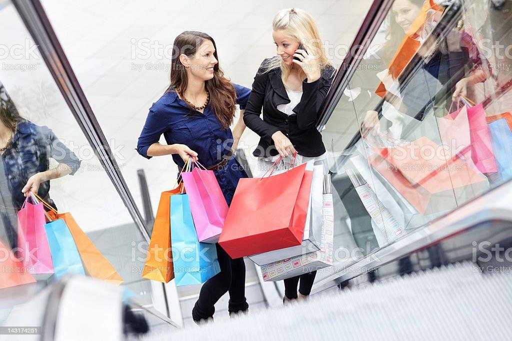girls on escalators royalty-free stock photo