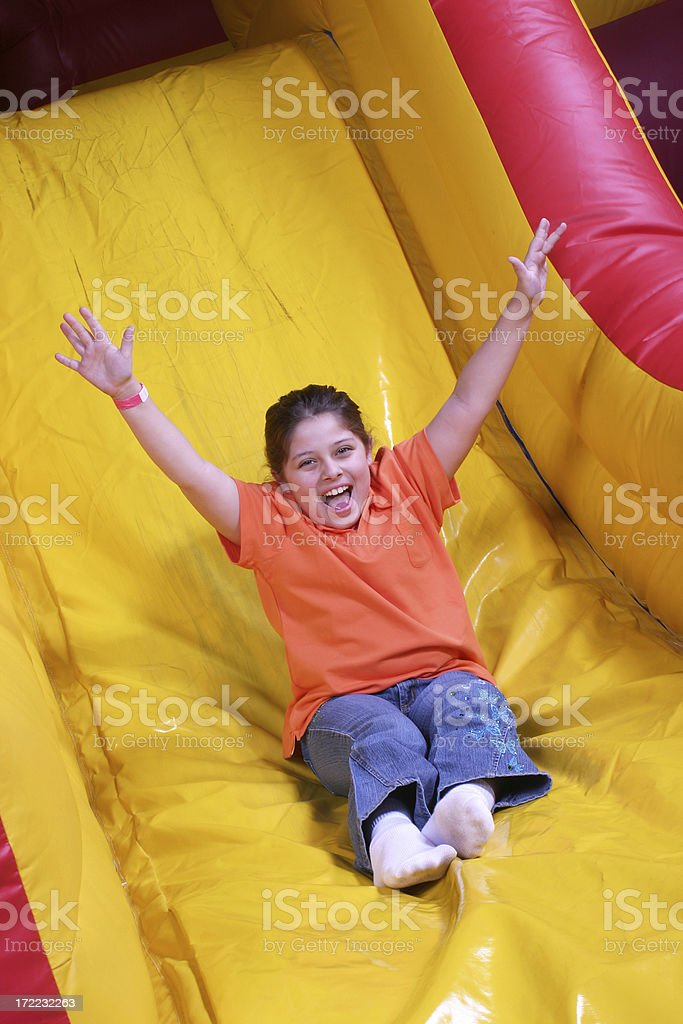 Girls on inflatable slide royalty-free stock photo