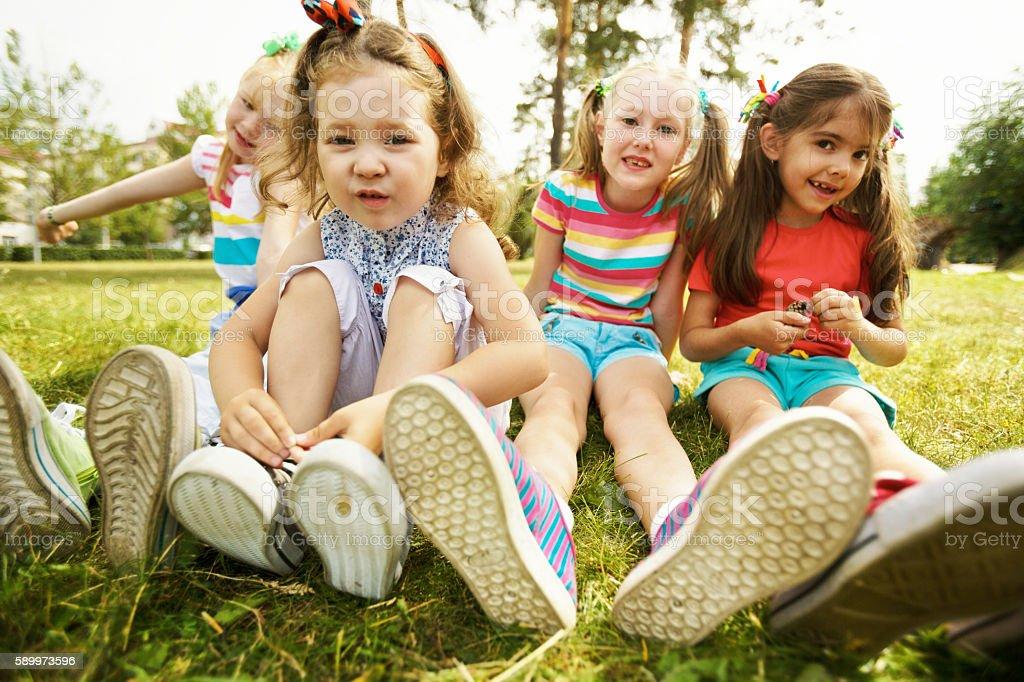 Girls on lawn stock photo