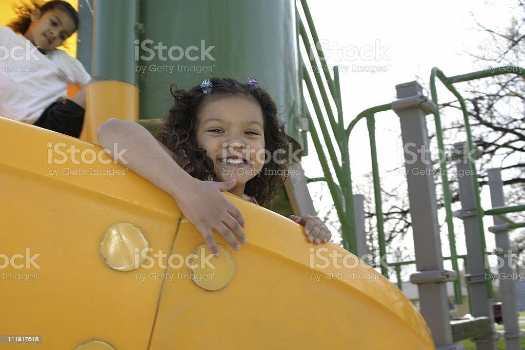 Girls On Playground Slide royalty-free stock photo