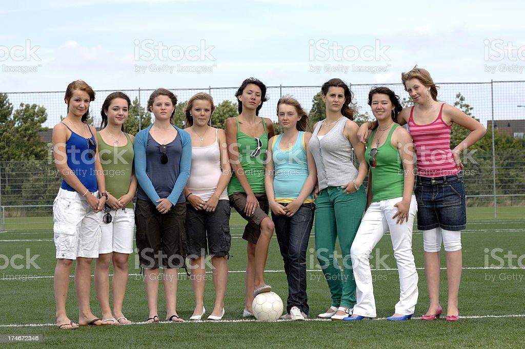girls on soccer field stock photo
