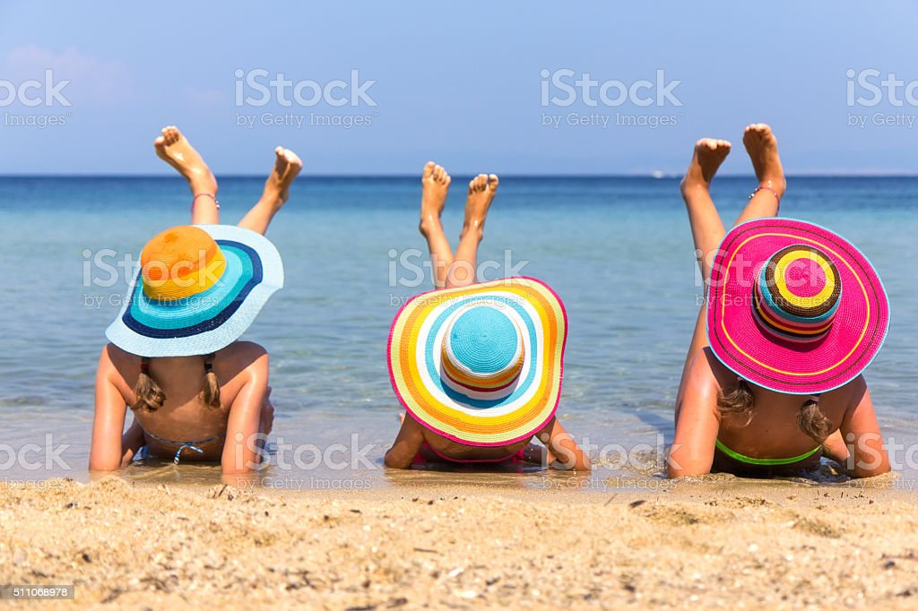 Girls on the beach stock photo