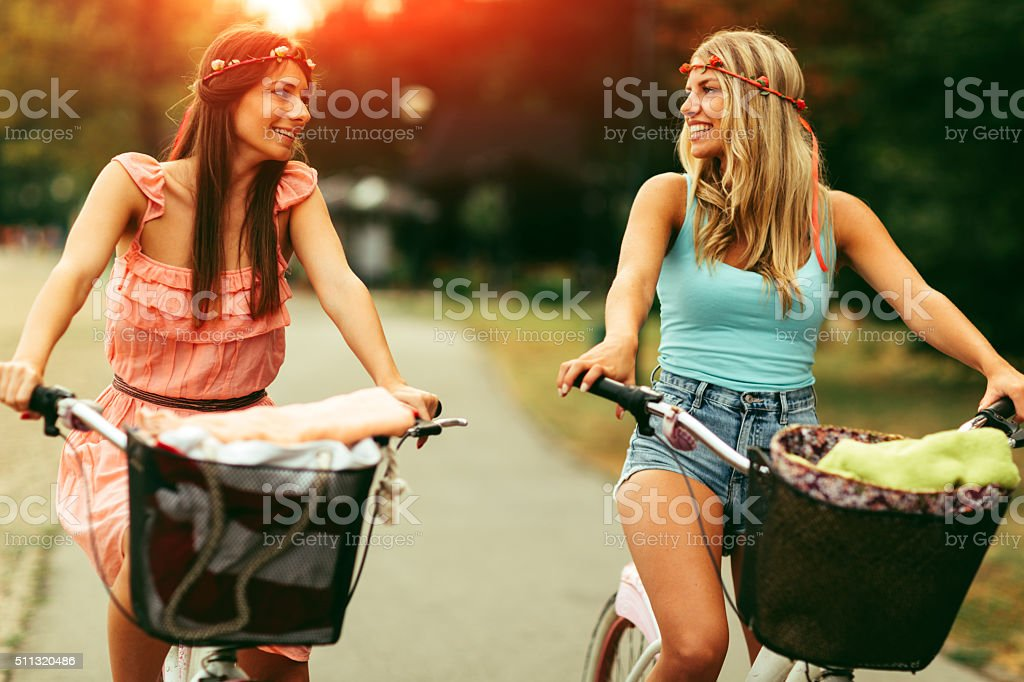 Girls On The Bicycle stock photo
