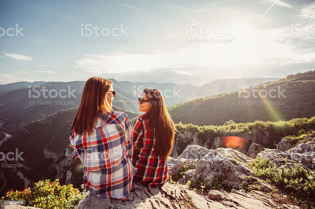 Girls on top of the world stock photo