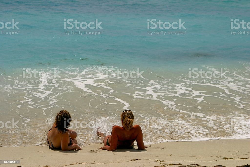 Girls on topical beach royalty-free stock photo