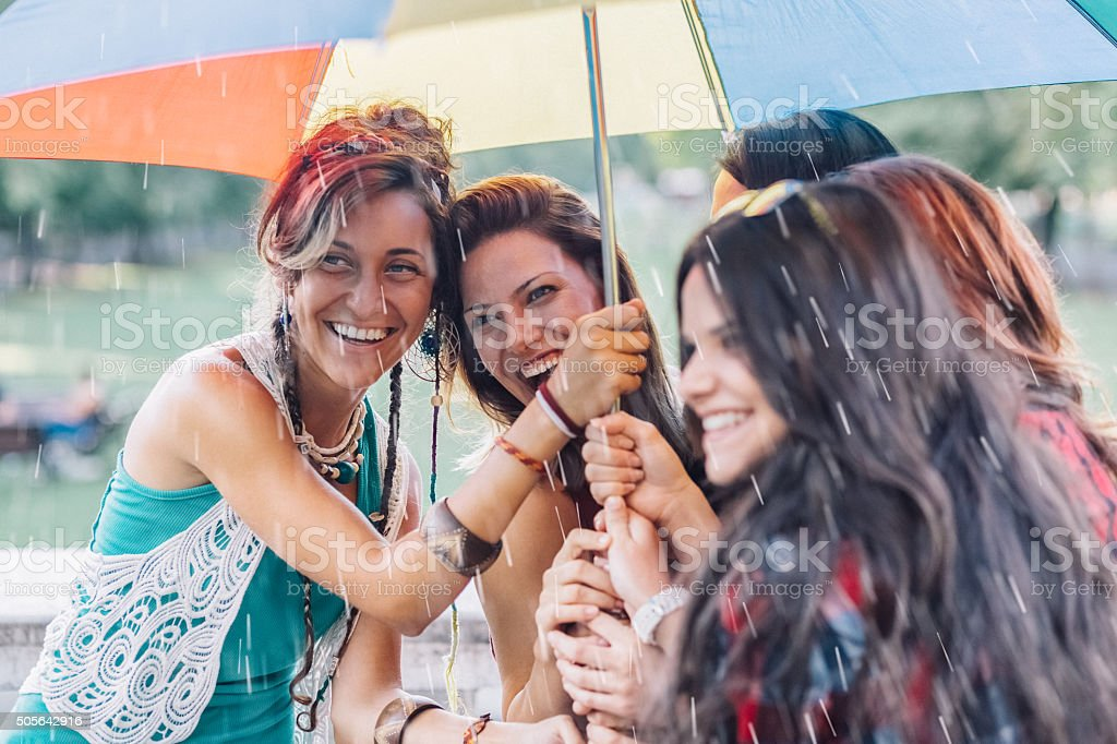 Girls outside on a rainy day stock photo