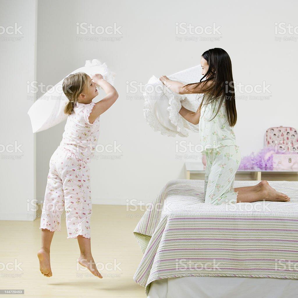 Girls Pillow Fighting stock photo