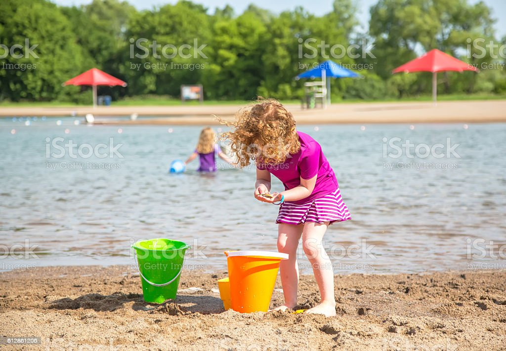 Girls Playing At Beach on Summer Day stock photo