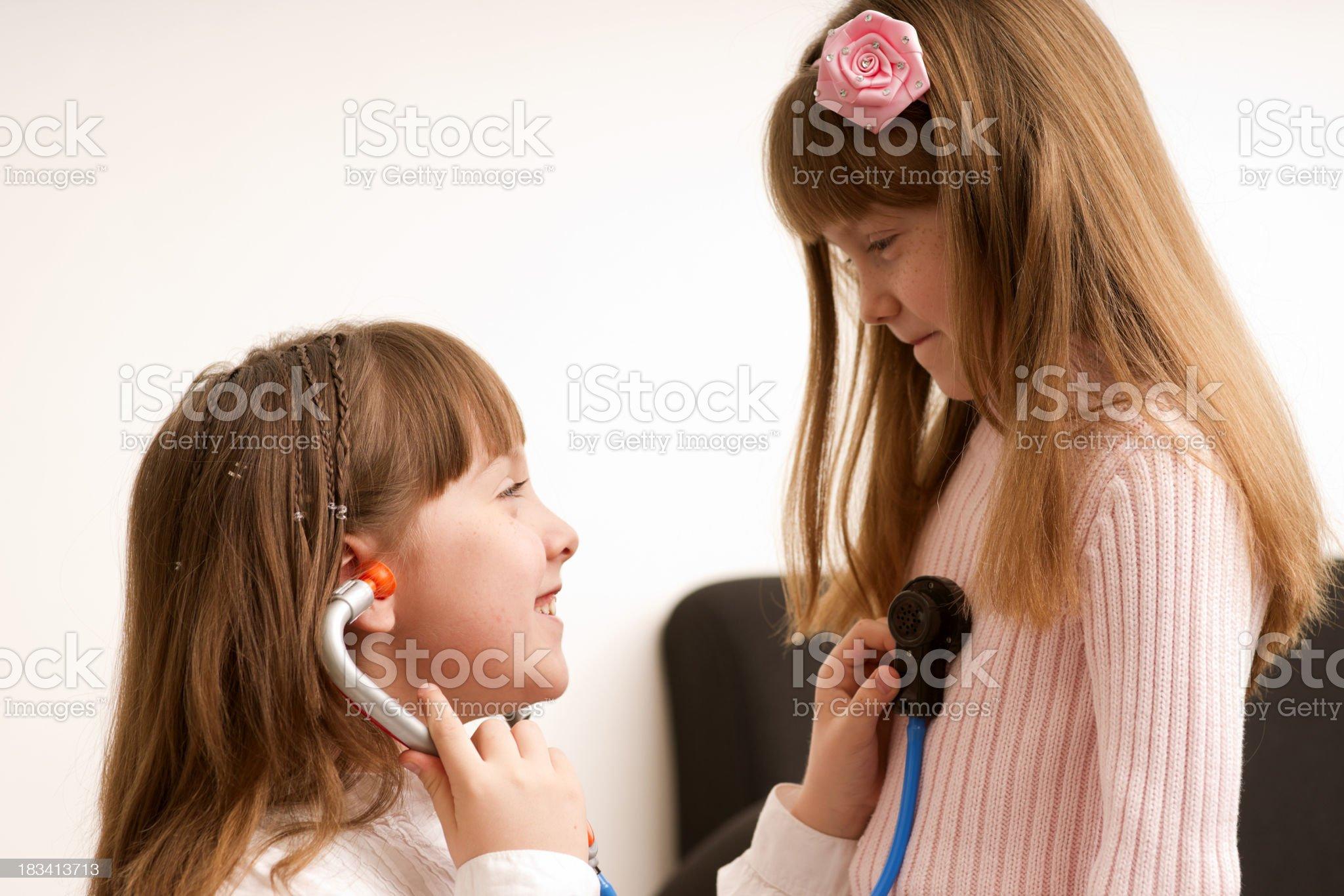 Girls Playing Doctor royalty-free stock photo