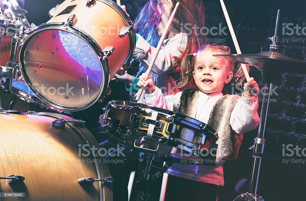 Girls playing drums stock photo
