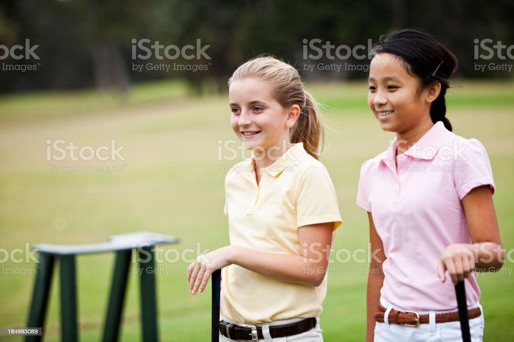 Girls playing golf stock photo