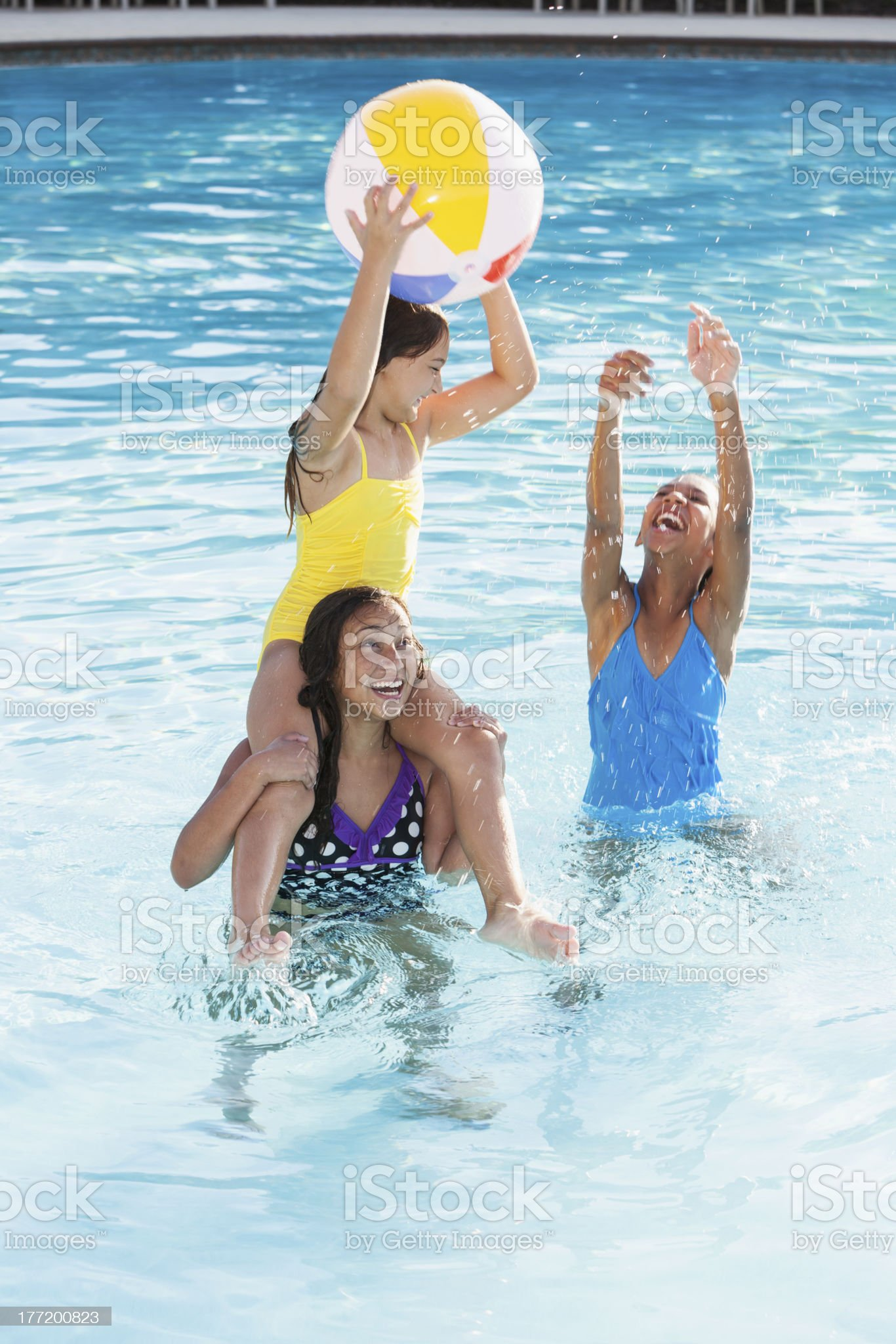 Girls playing in swimming pool. royalty-free stock photo