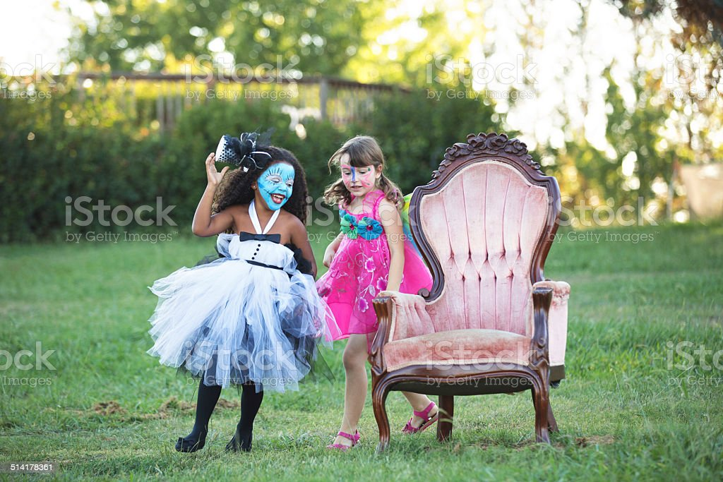 Girls Playing Musical Chairs at a Halloween Party stock photo