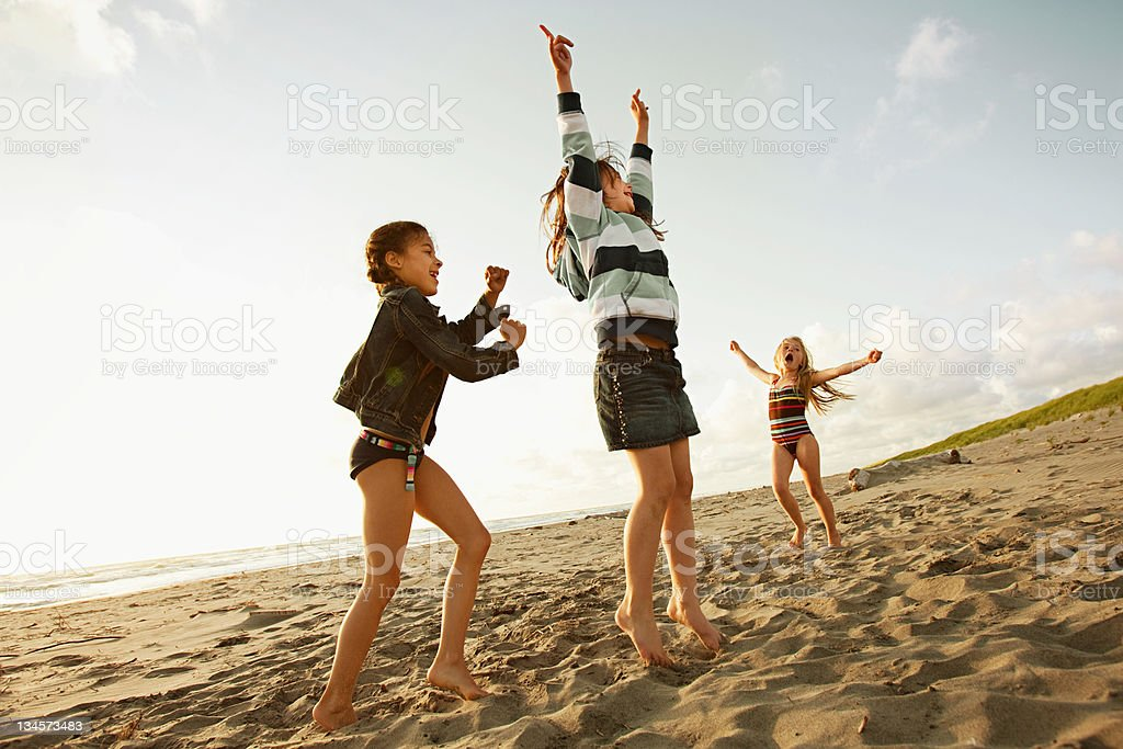 Girls playing on beach stock photo