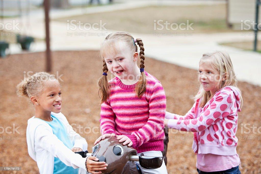 Girls playing on playground stock photo