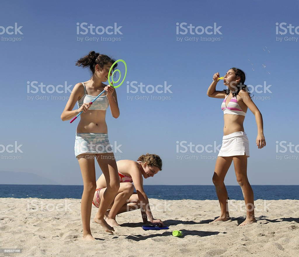 Girls playing on the beach royalty-free stock photo