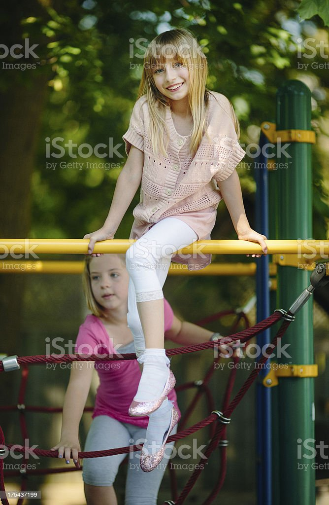 girls playing outdoors stock photo