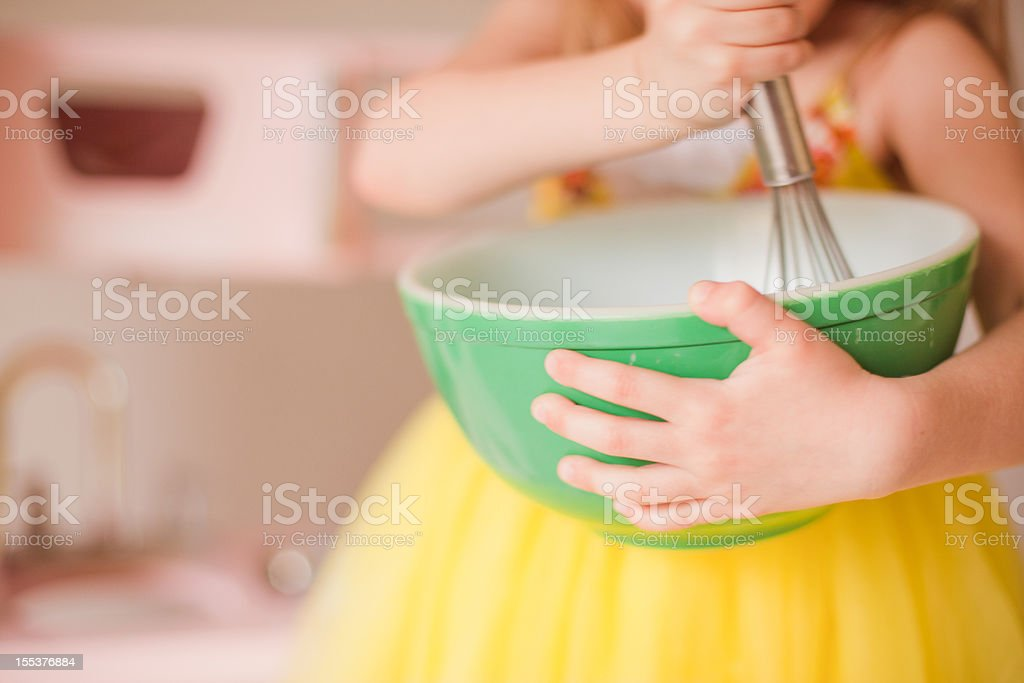 A girls playing pretend in her kitchen stock photo