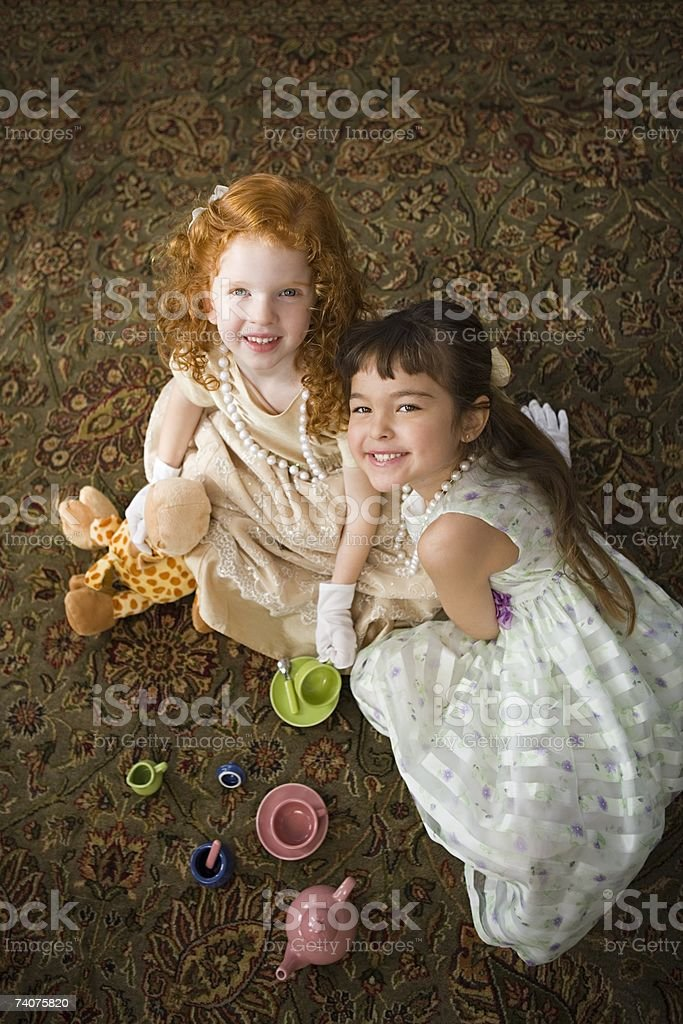 Girls playing tea party royalty-free stock photo
