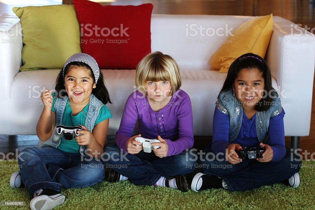 Girls playing video games royalty-free stock photo