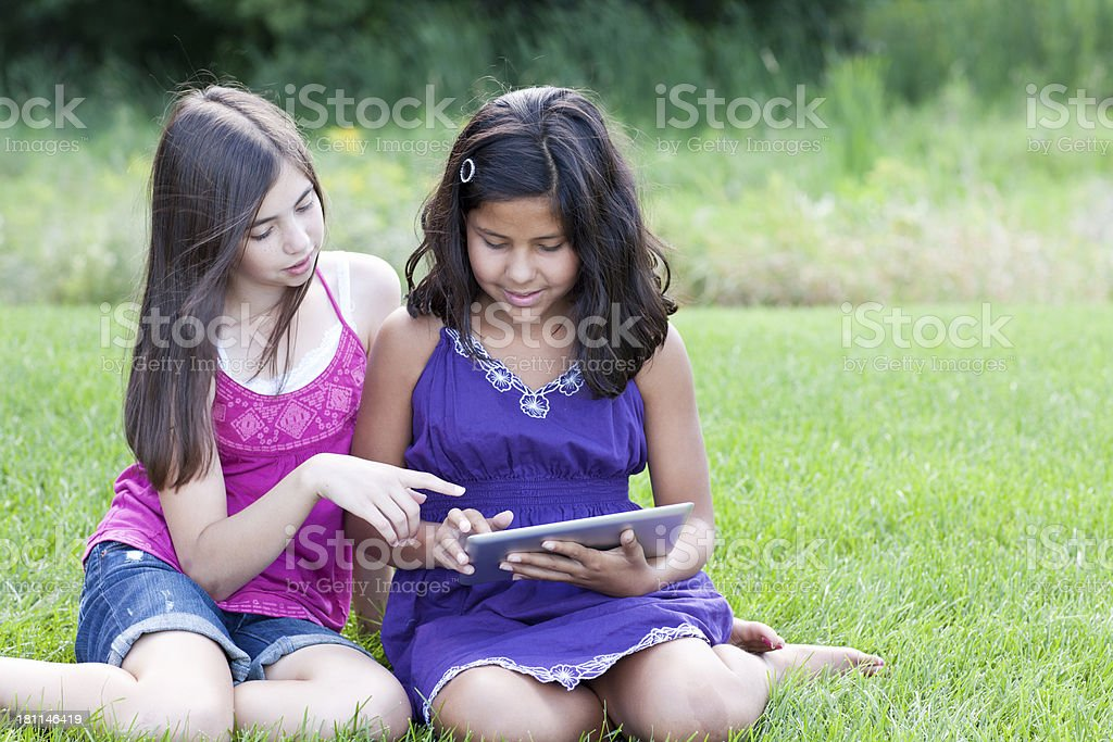 Girls Playing with a Digital Tablet royalty-free stock photo