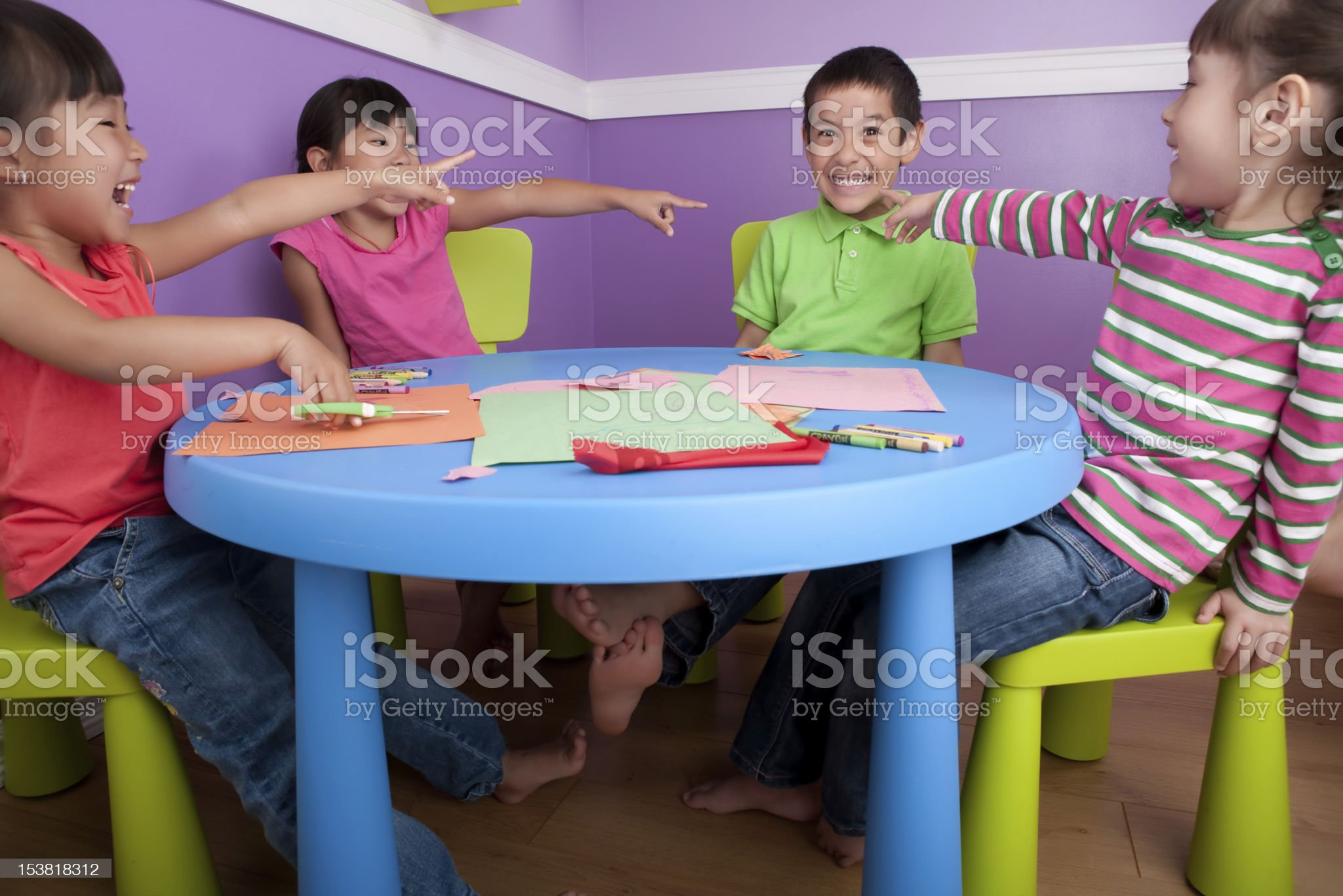 Girls pointing at a boy in class royalty-free stock photo