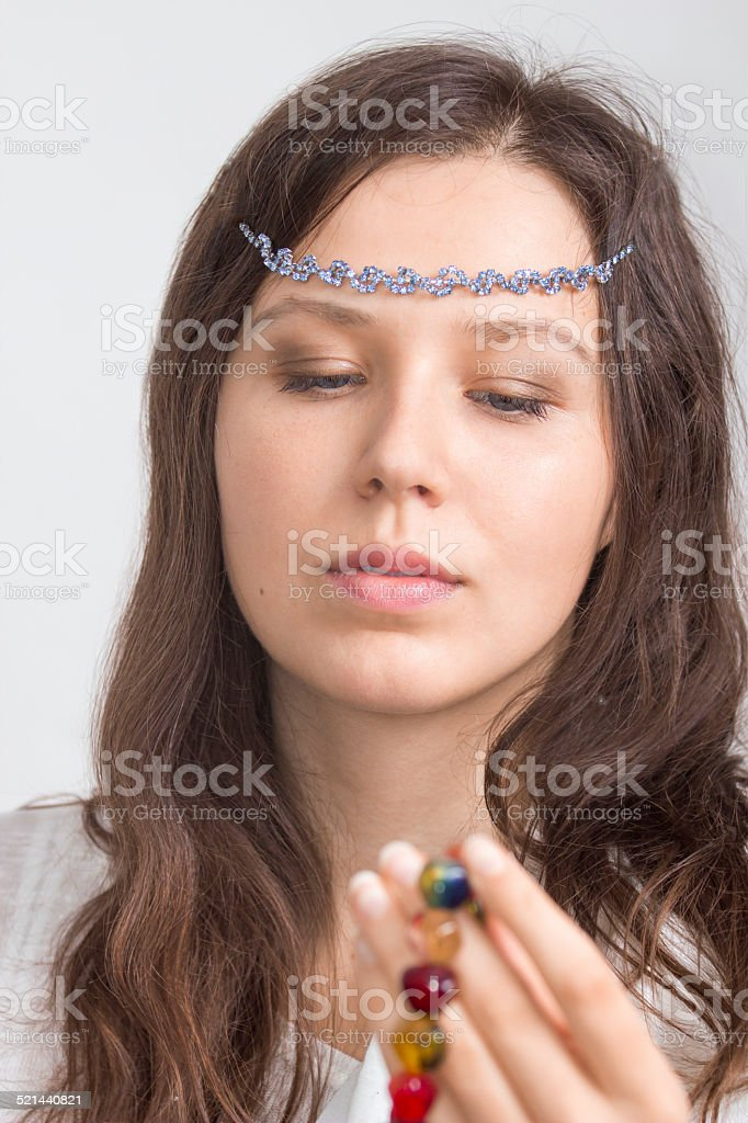 Girl's portrait with jewelry on a forehead stock photo