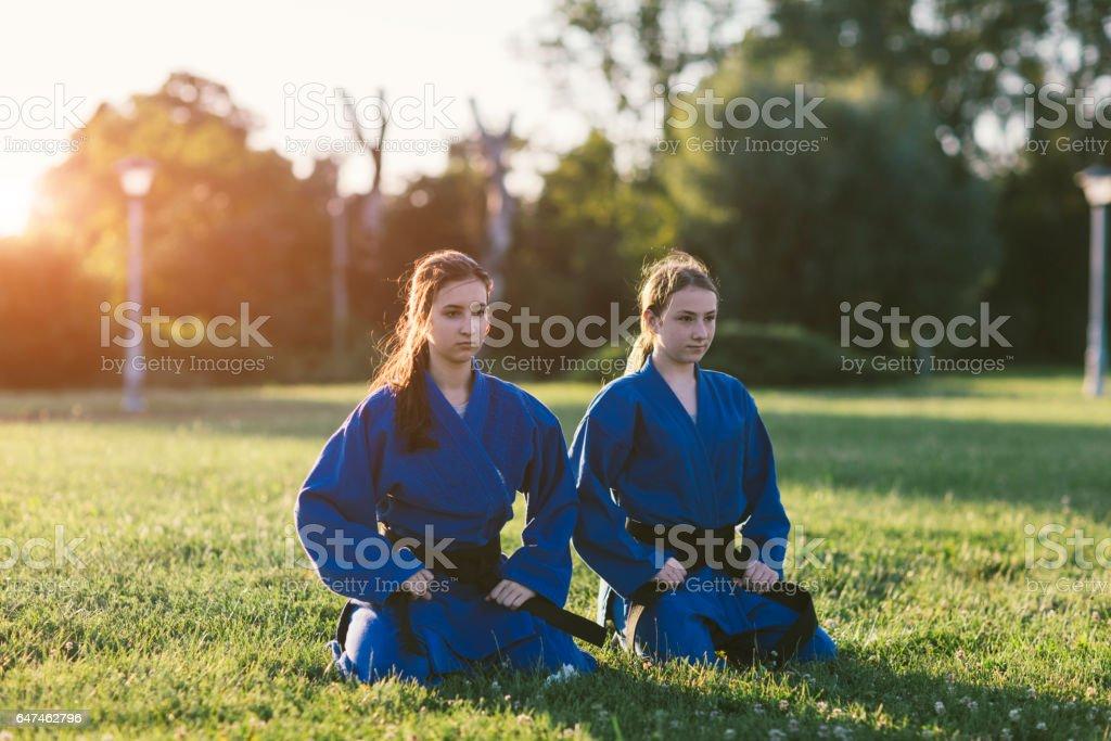 Girls Practicing Aikido stock photo