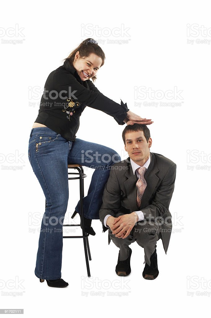 Girl's pressure on sitting man stock photo