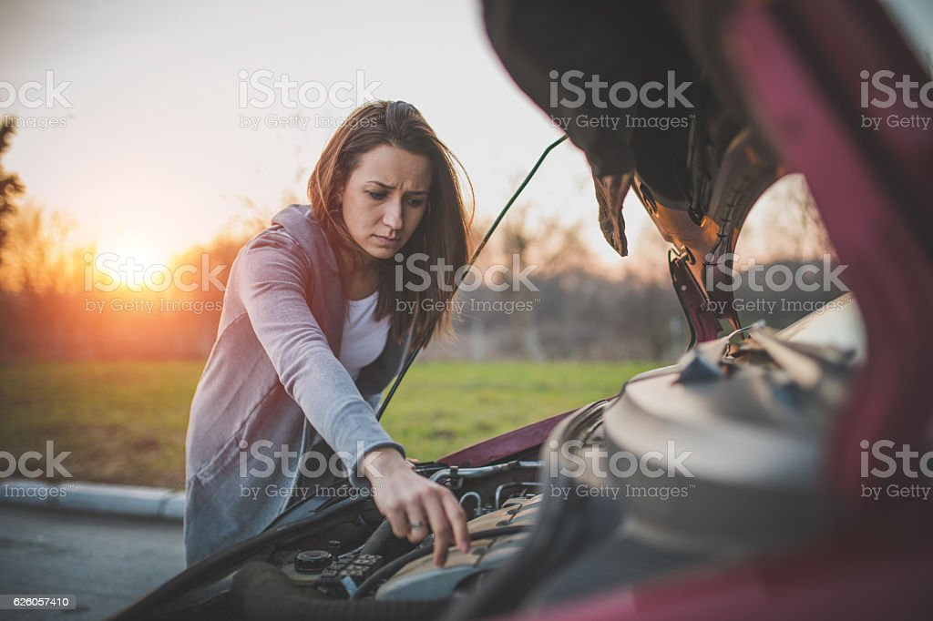Girls problems with car stock photo