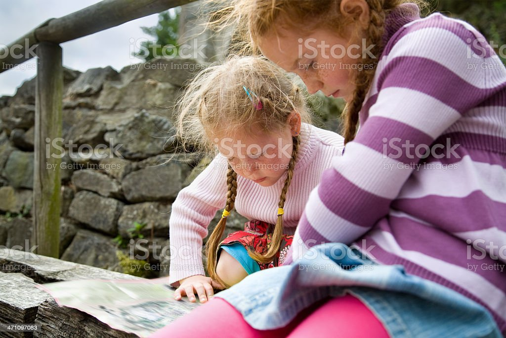 girls reading map royalty-free stock photo