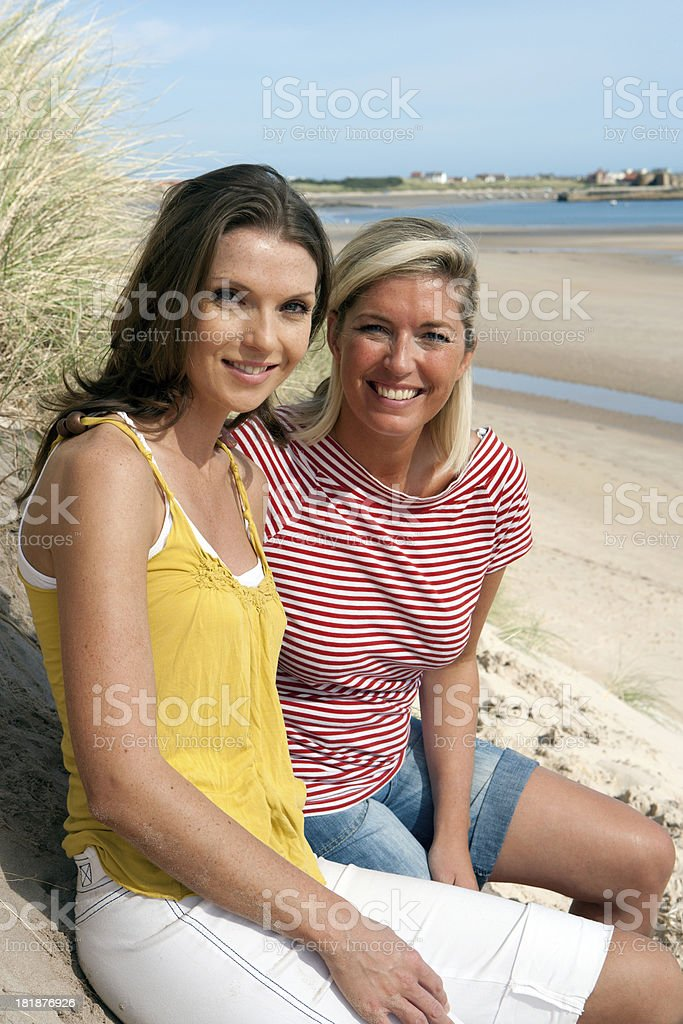 Girls Relaxing On Sand Dune royalty-free stock photo