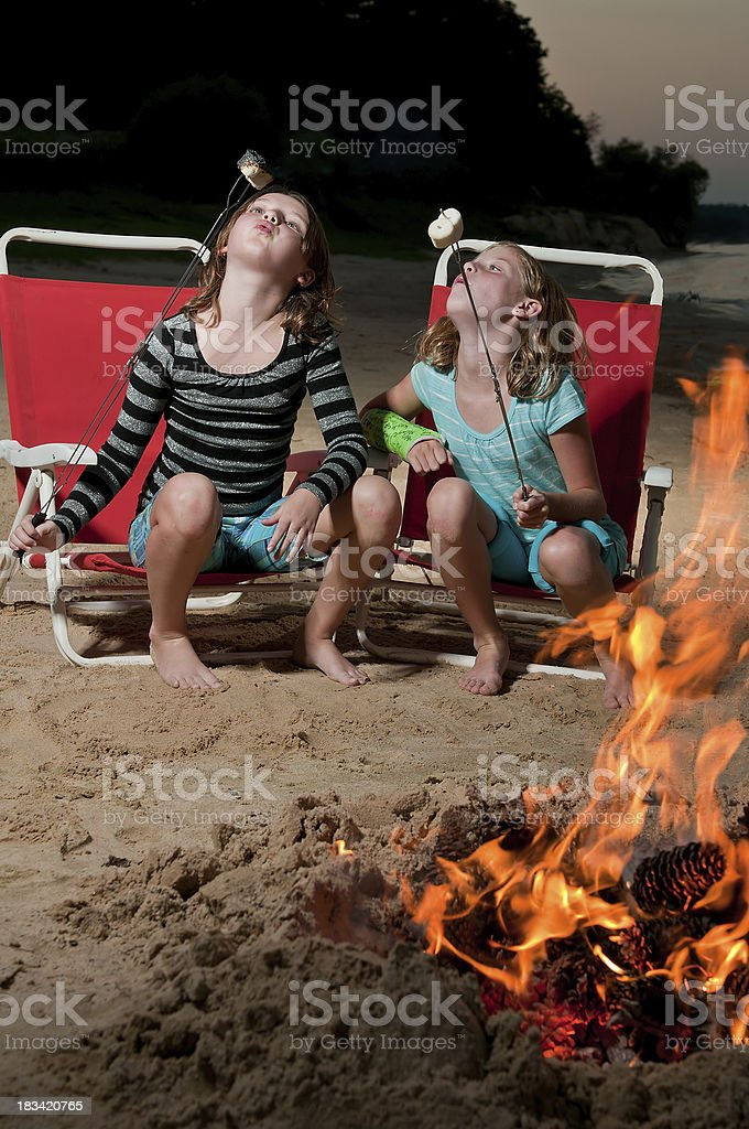 Girls roasting marshmallows royalty-free stock photo