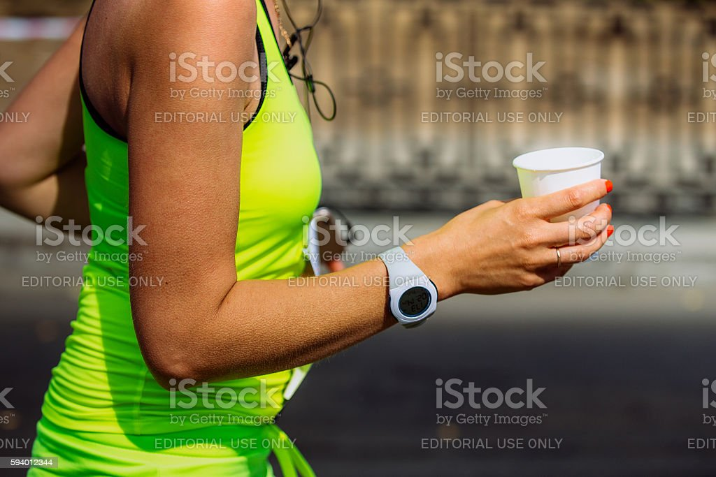girls runner hand holding a glass of water royalty-free 스톡 사진