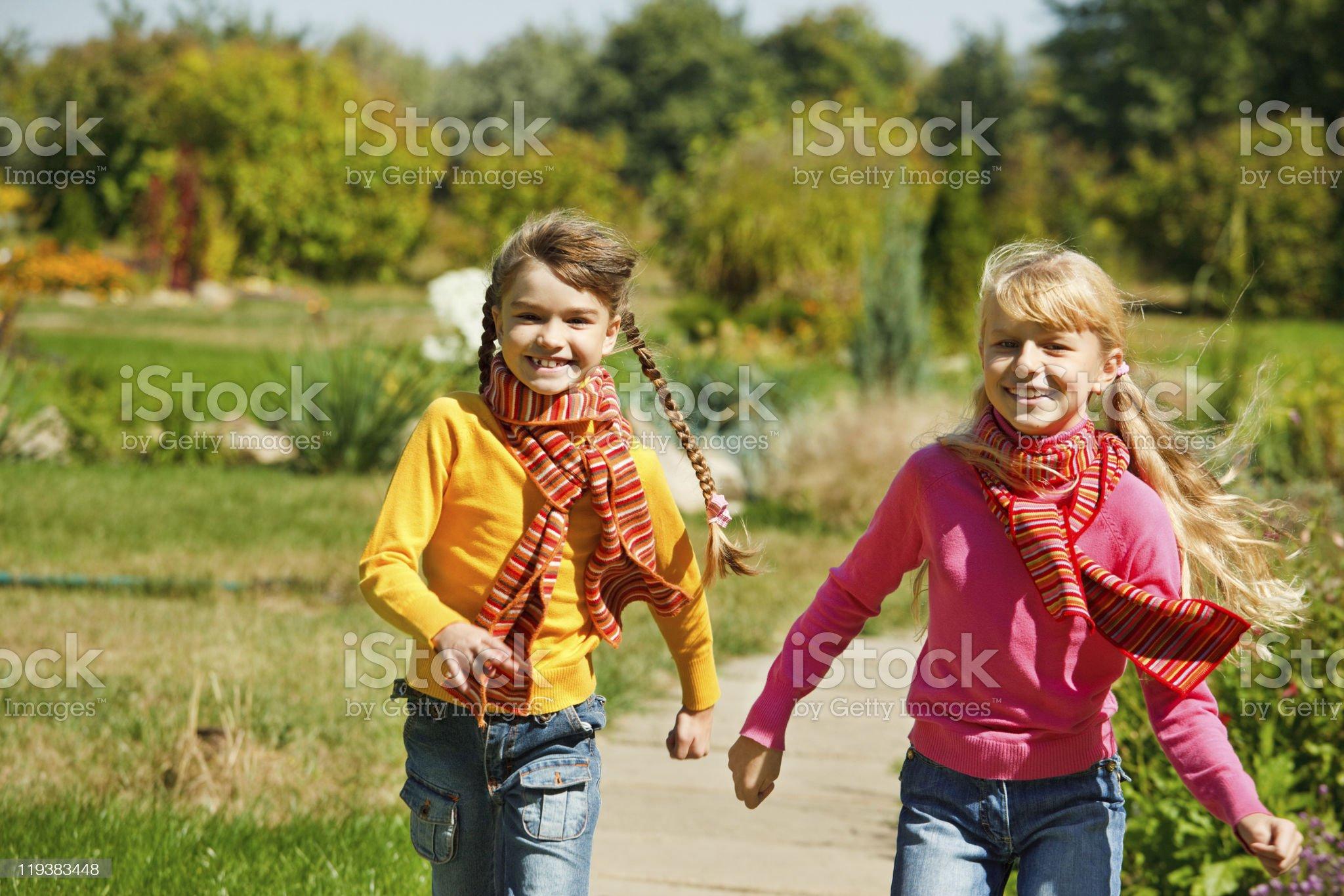 Girls running royalty-free stock photo