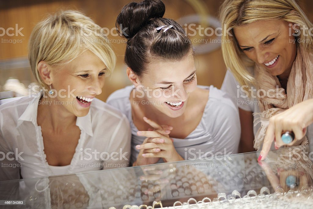 girls shopping in jewelry store stock photo