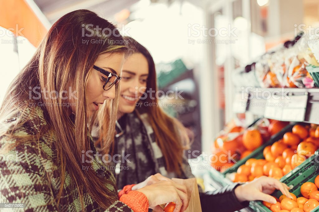 Girls shopping in the grocery store stock photo