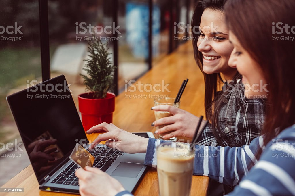 Girls shopping online with credit card stock photo