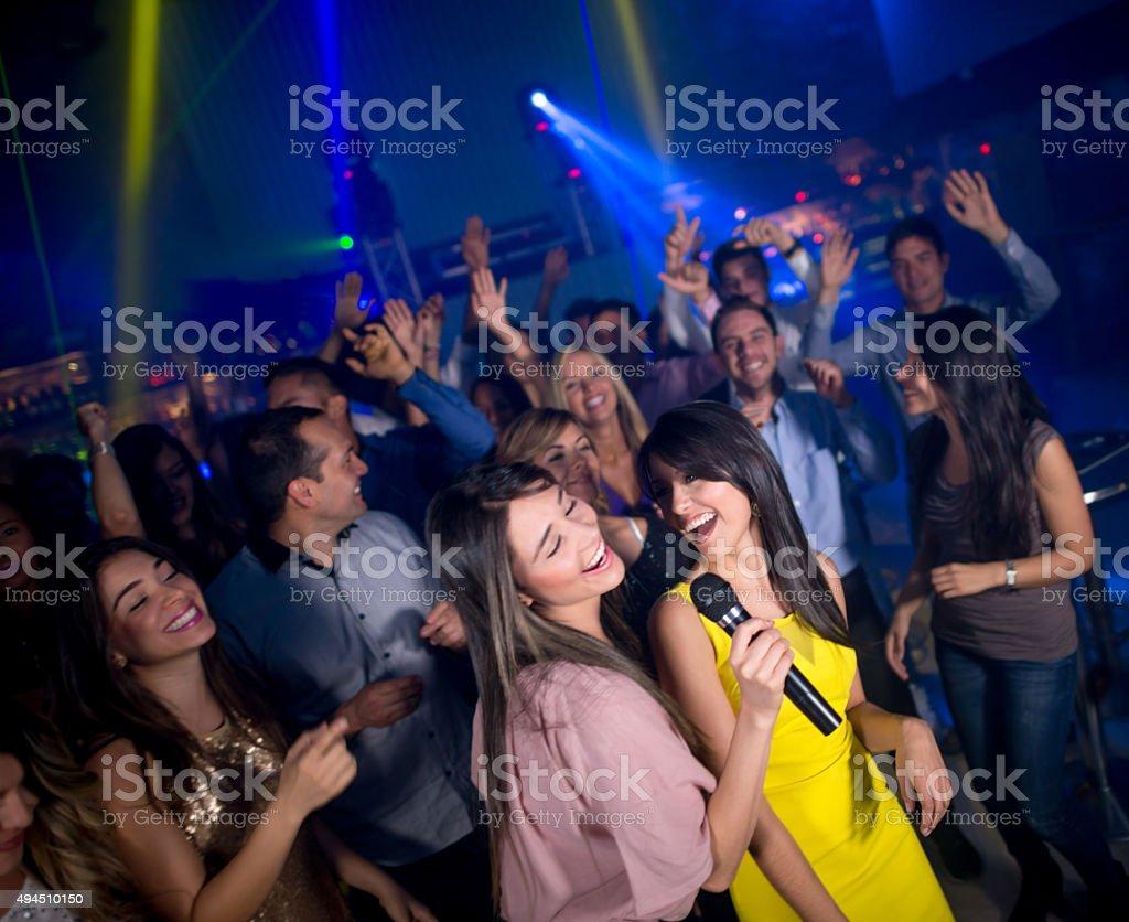 Girls singing at a nightclub stock photo