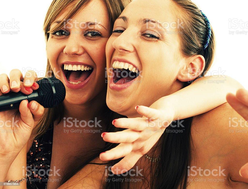 Girls singing stock photo
