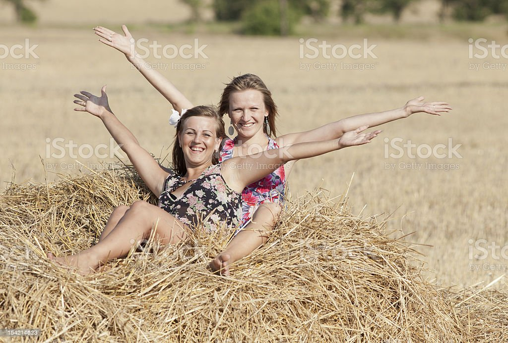 Girls sits on hayloft royalty-free stock photo