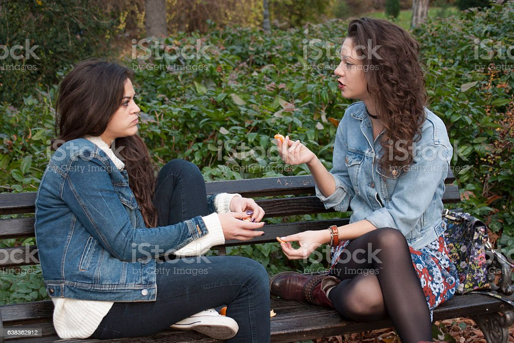 Girls sitting in the park stock photo