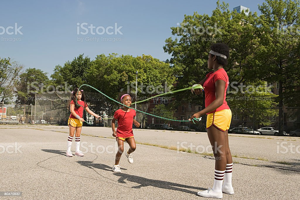 Girls skipping royalty-free stock photo