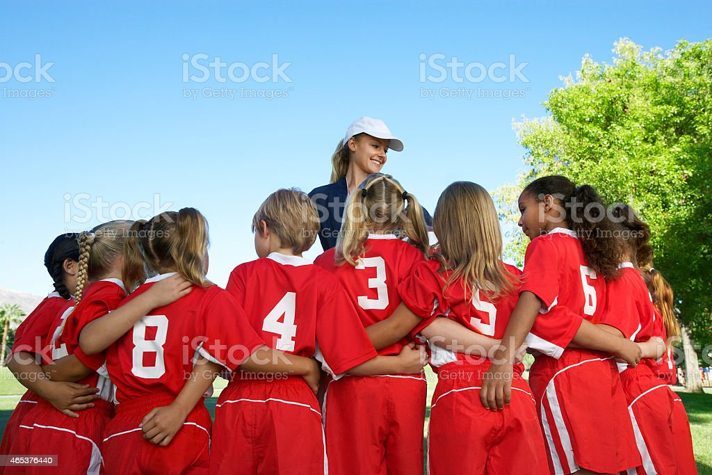 Girls soccer team and their coach stock photo