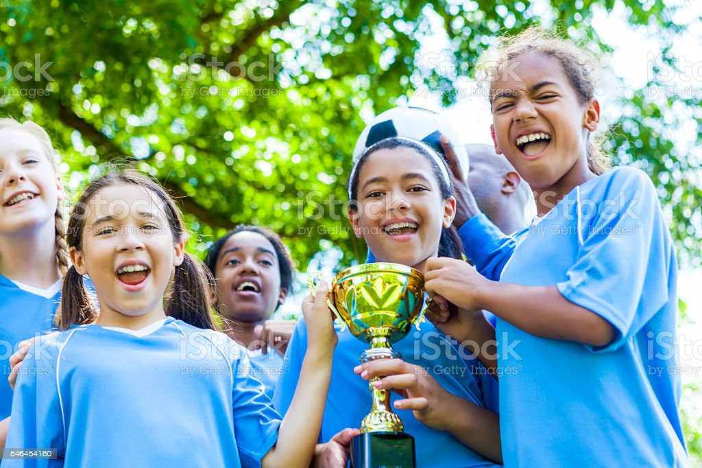 Girls soccer team celebrates victory stock photo