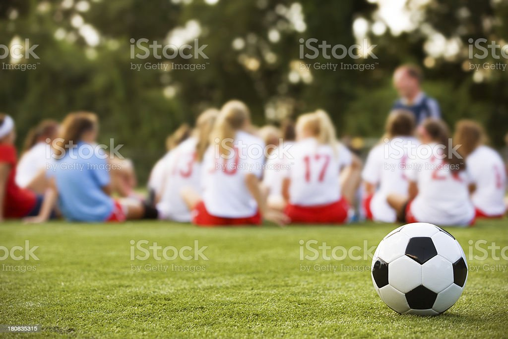 Girls soccer team listen to coach royalty-free stock photo