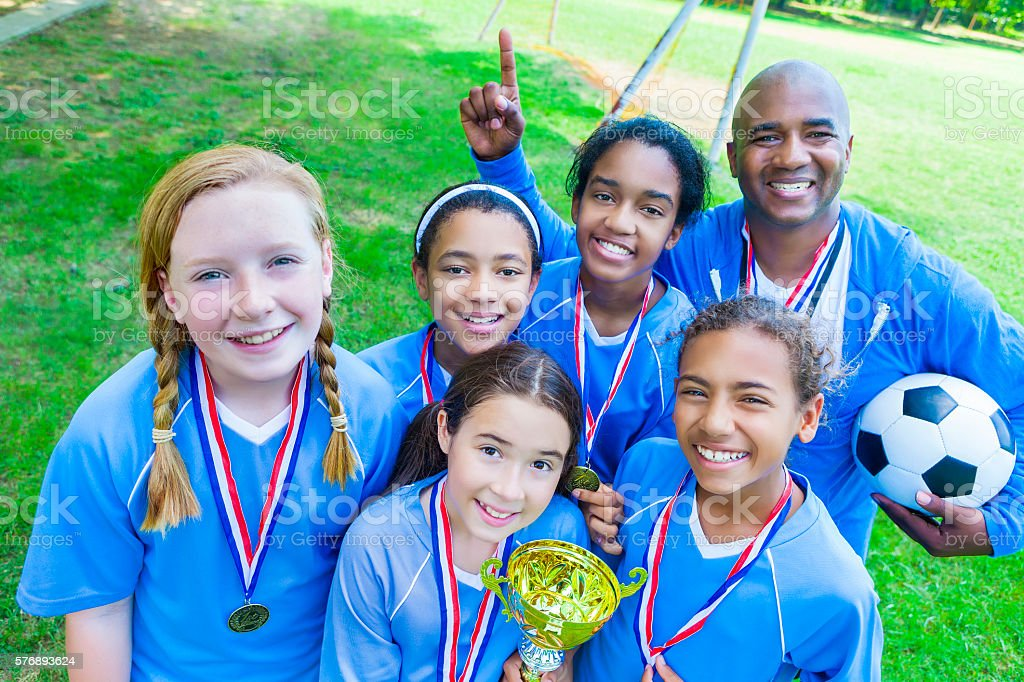 Girls soccer team wins first place stock photo
