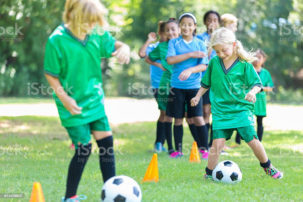 Girls soccer teams practice together stock photo