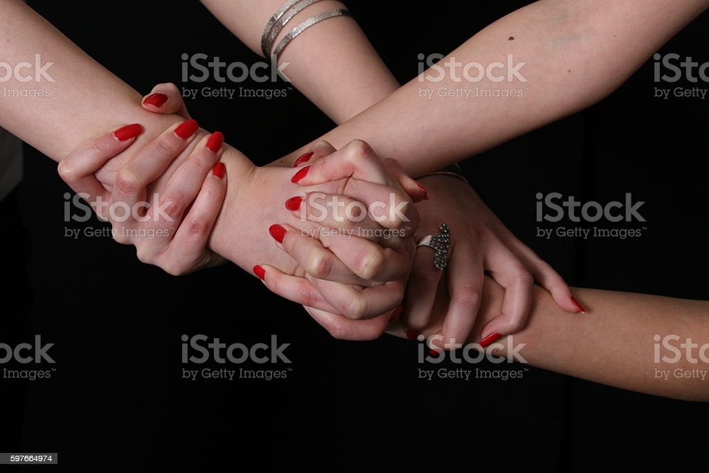 Girls squeezing fingers stock photo